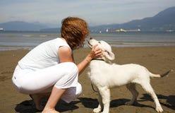 Kiss to her dog stock photos