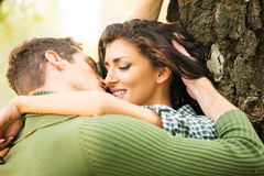 Kiss By The Tree Royalty Free Stock Photos