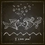 Kiss of two fishes drawing. With chalk on a blackboard Royalty Free Stock Photos