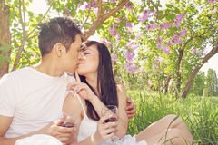 Kiss under the lilacs Stock Images