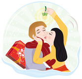 Kiss under the mistletoe stock photo