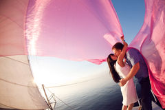 Kiss under the sail Stock Photos
