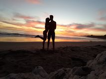 A kiss under the sunset. A dream. Cloudy sunset at the beach with a special person. Santa Barbara, California, USA Stock Images