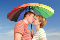 Kiss under umbrella Royalty Free Stock Image