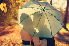 Kiss under the umbrella Stock Photography