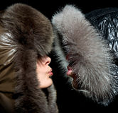 Kiss in the winter of men and women Royalty Free Stock Images