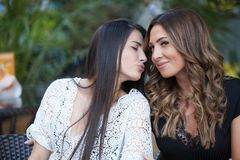 The kiss of a woman. Lovely young women having fun in the city streets Royalty Free Stock Photo