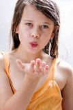 Kiss for you. Young beautiful girl blow a kiss to you Stock Photo