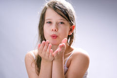 Kiss for you. Young beautiful girl blow a kiss to you Royalty Free Stock Photos