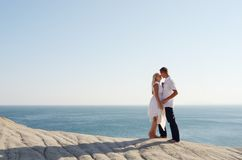 Kiss of a young couple near the Sea Stock Images