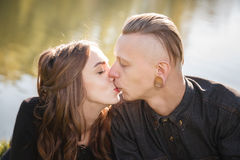 Kiss. Young male kissing female close-up Royalty Free Stock Photography