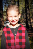 Kissable Dressed Up Country Boy. A kissable little country boy stands in the sunshine grinning with hair all slicked down, wearing a red plaid vest.  Shallow Stock Images