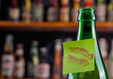 Kissed. Green beer bottle with a kissed note Stock Image