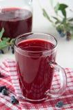 Kissel of honeysuckle berries in glass royalty free stock image