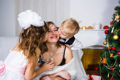 Kisses for darling and gentle mother Stock Photography