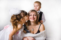 Kisses for darling and gentle mother Stock Images