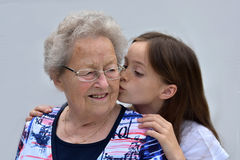 Kisses for grandma Stock Photo