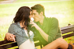 Kisses On A Park Bench Stock Photography