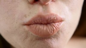 KissesAn extreme close up shot of lips making kissing faces stock video