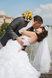 Kissin of groom and bride in their wedding day Stock Photography