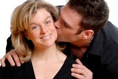 Kissing. Man kissing cute blond on the cheek Stock Photography