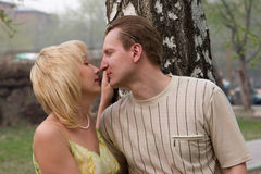Kissing. Happy couple kisses in park Stock Photography