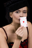 Kissing ace. Attractive blond woman kissing the back of an ace of hearts for good luck Stock Image