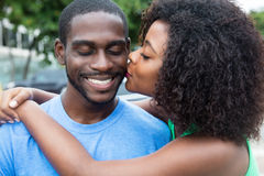 Kissing african american couple Royalty Free Stock Images