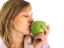 Kissing an apple Stock Photos