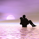 Kissing At Sunrise Royalty Free Stock Images