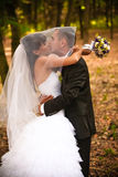 Kissing in autumn forest Stock Images