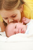 Kissing the baby Stock Photo