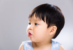 Kissing baby boy Stock Images