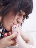 Kissing baby feet Stock Image