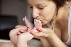 Kissing baby feet Royalty Free Stock Images