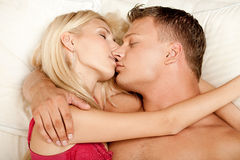 Kissing in bed Stock Photo