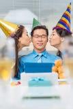 Kissing birthday man Stock Photography