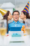Kissing birthday man Stock Image