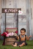 The Kissing Booth. Adorable toddler at a Kissing Booth Stock Images