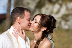 Kissing Bridal Couple Royalty Free Stock Images
