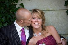 Kissing the bride Royalty Free Stock Image