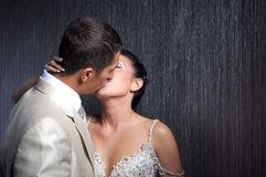 Kissing bride and groom Royalty Free Stock Photos