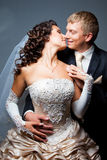 Kissing bride and groom Royalty Free Stock Images