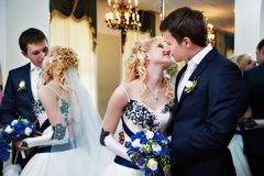Kissing bride and groom Royalty Free Stock Photo