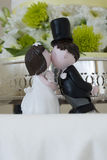 Kissing bride and groom figurines Stock Photos