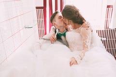 kissing bride and groom having fun in bathroom royalty free stock photos