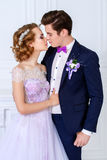 Kissing bride and groom royalty free stock photography