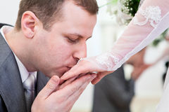 Kissing bride`s hand Royalty Free Stock Photography