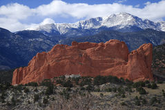 Kissing Camels and Pike's Peak. Red sandstone impression of camels kissing, with Pike's Peak behind royalty free stock photography