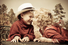 Kissing children Royalty Free Stock Photo